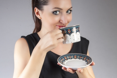 an image of businesswoman drink coffee Stock Photo - 22673826