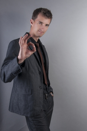 an image of businessman showing OK sign photo