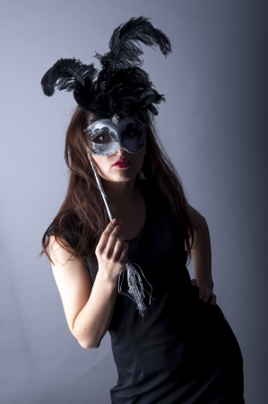 an image of beautiful young girl with venetian mask photo