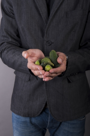 an image of vegetarian vegetable businessman holds in hands photo