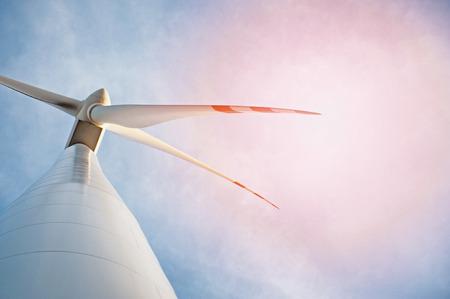 Wind turbine against deep blue sky -