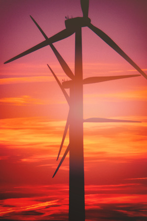 Wind turbine farm with rays of light at sunset Foto de archivo