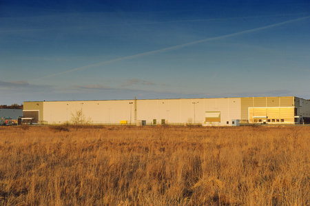 food distribution: Modern industrial exterior building over blue sky Stock Photo
