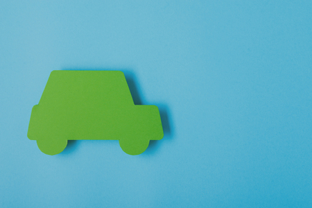 laughable: paper green cars figure. top view on blue background