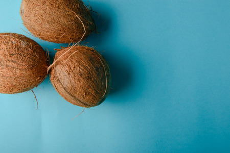Coconut isolated on blue Background. High resolution Stock Photo