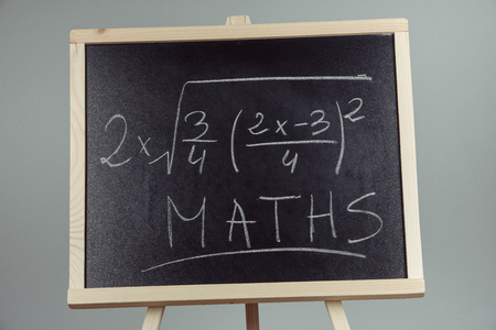 mathematical proof: Math exercise written on the chalkboard. Gray background Stock Photo