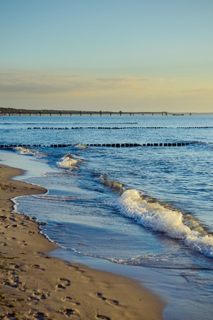 breakwaters: Breakwaters in the Baltic sea over the sunset in summer