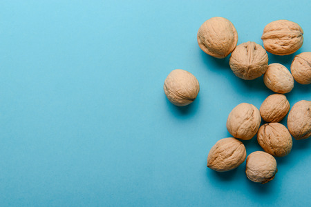 nutshells: Walnuts, walnuts close-up, walnuts on a blue background