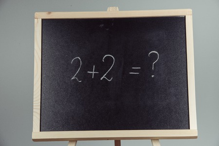 teorema: Math exercise written on the chalkboard. Gray background Foto de archivo