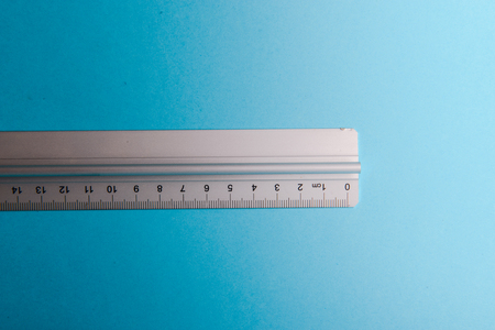 aluminum ruler on blue background. High resolution Stock Photo