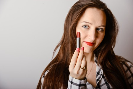 portrait of beautiful delicate brunette woman with red lipstick photo