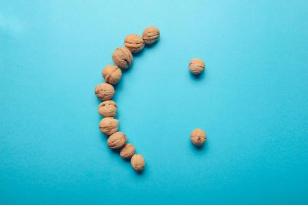 Walnuts, walnuts close-up, walnuts on a blue background