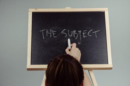 subject written in white chalk on a black chalkboard . gray background Stock Photo