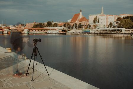 Professional urban photographer taking picture in city. Long exposure photography