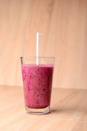 Blueberry smoothie with fresh berries, chia seeds and banana for breakfast on rustic wooden background, selective focus Reklamní fotografie