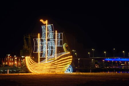 Illuminated straw ship located in the city. Szczecin at night