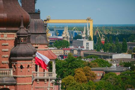 Cityscape with yellow cranes in the background in Szczecin Poland