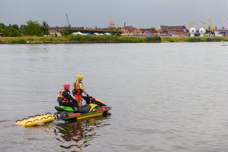 Szczecin, Poland - June 10, 2018: Life guards on a scooter patrolling in the Odra river. Days of Odra festival.