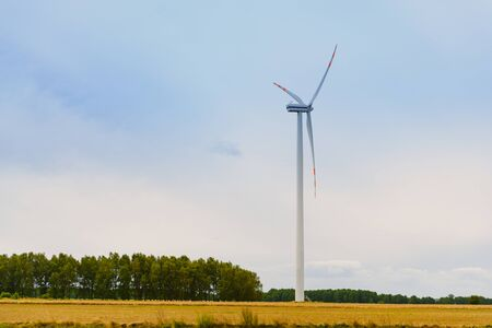 Windturbine. Eco power renewable energy production from wind. Windmill saves the earths natural ingredients. Green ecology and pure electricity. Zdjęcie Seryjne