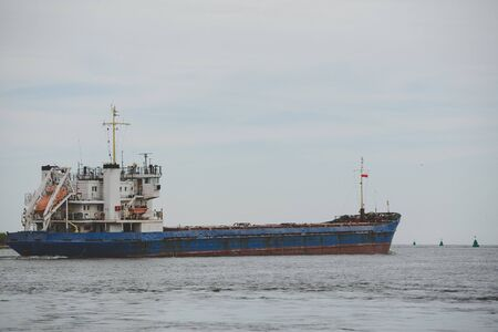 Transport vessels depart from the port in Swinoujscie to the open Baltic Sea Imagens