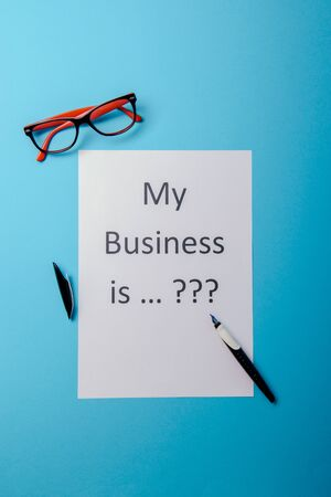 My business is word concept. Business word with business document paper on blue background. For business concept ideas background.