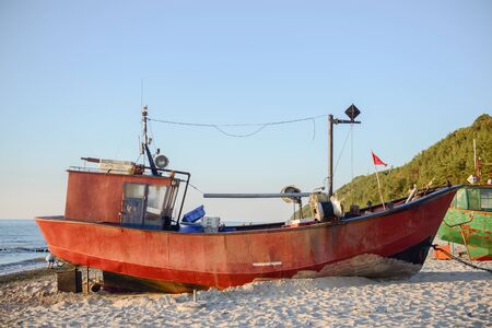 fisherman boats at sunrise time on the beach in summer