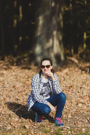 Autumn attractive woman portrait smiling outdoors at the park. Authentic and natural photographs Stok Fotoğraf