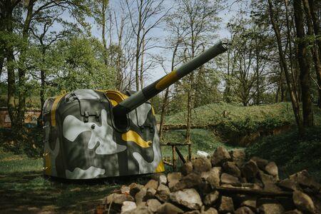 German old green rusty anti-aircraft machine gun outdoor. Stock Photo