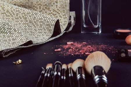 A photograph of Isolated make-up powder with brush on black background Archivio Fotografico - 133481060
