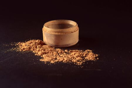 Isolated make-up powder with container on black background. Archivio Fotografico - 133481092