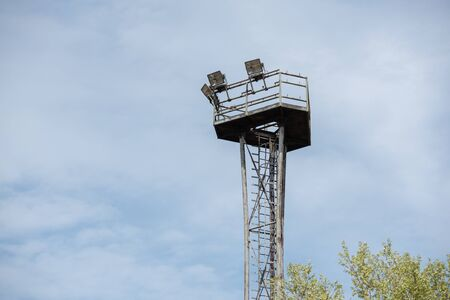 Observation tower with copy space. Blue sky and green trees