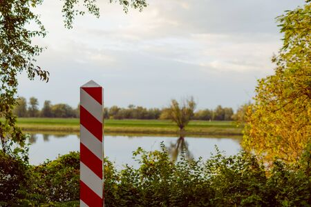 Polish border post splitting from Germany through Odra river Stock Photo