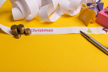 Long twisted expanded letter for Santa Claus. Copy space. yellow background Stock Photo