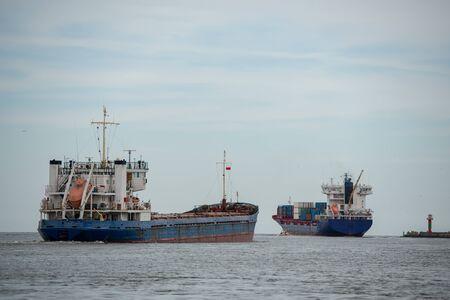 Transport vessels depart from the port in Swinoujscie to the open Baltic Sea Banco de Imagens