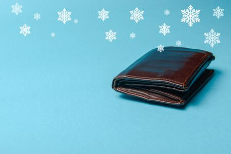 brown mans leather wallet on a blue background