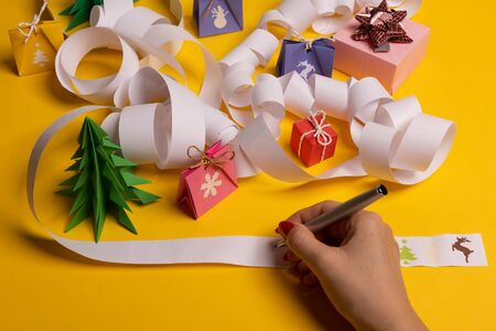 Long twisted expanded letter for Santa Claus. Copy space. yellow background