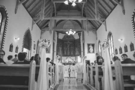 Church sanctuary before a wedding ceremony. Empty chairs for bride and groom 版權商用圖片