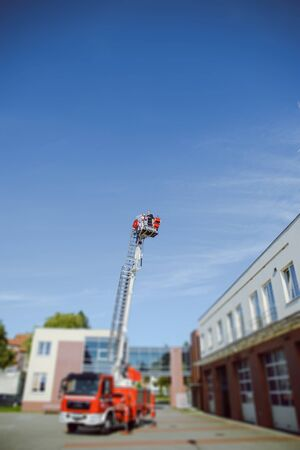 Beautiful wedding couple on outdoor photoshoot with fire truck