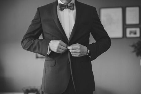 Grooms wedding accessories. Bow tie, suit, cufflinks, belt and shoes Фото со стока