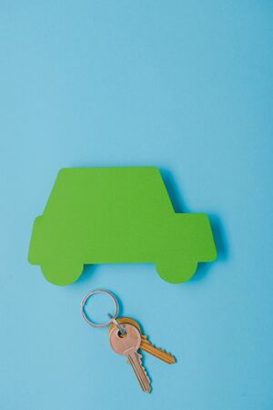 paper green cars figure with keys. top view on blue background Stok Fotoğraf