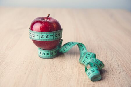 One ripe red apple with measuring tap around Stock Photo