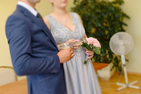 first toast of the bride and groom with a glass of champagne Stock Photo - 138927356