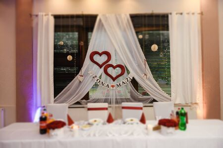 Beautifully decorated wedding table and other details at wedding hall. Wedding day Stock Photo