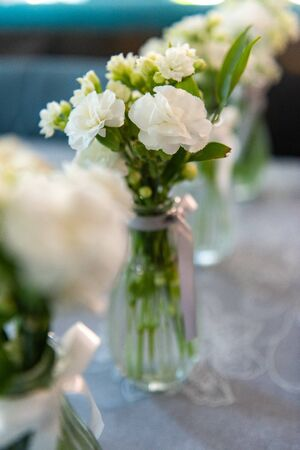 bouquet in the hands of the bride. Stock Photo