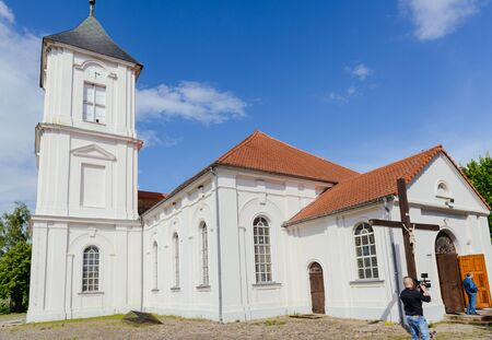 Church exterior during wedding ceremony. Blue sky with sunny weather Stock Photo - 138927374