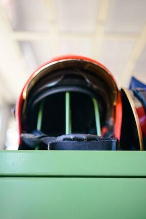 Red firefighter helmet close up at firestation