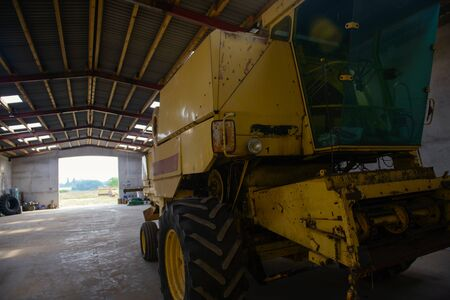 combine harvester standing ready for harvest in a warehouse Stock Photo