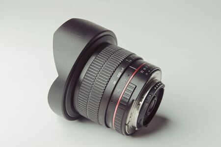 close up of a camera photo lens on white