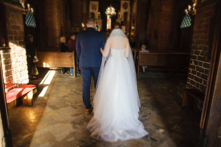 Bride and groom at church wedding during ceremony. Beautiful decoration