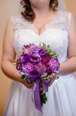 bouquet in the hands of the bride. Stock Photo - 138927452